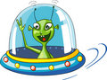 Funny green extraterrestrial in spaceship Stock Photo