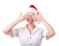 Funny grimace simple young woman in santas hat Royalty Free Stock Images