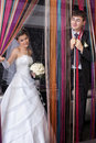 Funny groom and smiling bride Royalty Free Stock Image