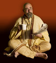 Funny Guru with Newspaper Stock Image
