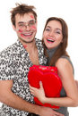 Funny guy nerdy and glamorous girl Royalty Free Stock Image