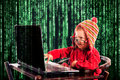Funny hacker little child typing on the keyboard selective focus on the child Stock Photos