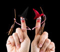 Funny halloween witches caricature made of a finger puppet representing two Royalty Free Stock Photos