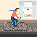 Funny handsome guy rides a bike is riding and checking his account in twitter used clipping mask for street Stock Photography