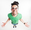 Funny handsome man with hipster glasses showing his palms and smiling large wide angle shot view from above Royalty Free Stock Photo