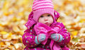 Funny happy baby girl child outdoors in the park in autumn on walk Royalty Free Stock Photo