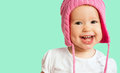 Funny happy baby girl in a pink winter knitted hat laughing child Royalty Free Stock Photography