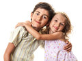 Funny happy kids hug little boy and girl sharing a smiling concept of love isolated on white Royalty Free Stock Photos
