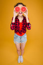 Funny happy young woman with halves of grapefruit over eyes Royalty Free Stock Photo