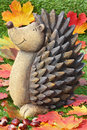 Funny hedgehog with colorful leaves and chestnuts Royalty Free Stock Images