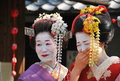 Funny henshin. Laughing Geishas spotted in Kyoto. Royalty Free Stock Photos