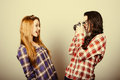 Funny hipster girls portraying with an old film camera plaid shirt and retro eye glasses retro filter effect added Stock Photography