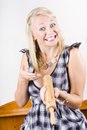 Funny housewife with excited expression showcasing brand new wooden rolling pin when baking Stock Images