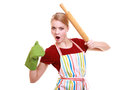 Funny housewife kitchen apron oven mitten holds rolling pin isolated crazy emotional or baker chef wearing green baking studio Royalty Free Stock Photos
