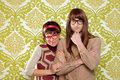 Funny humor nerd couple on vintage wallpaper Royalty Free Stock Photos