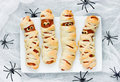 Funny idea for kids for Halloween food - sausage in dough as a m Royalty Free Stock Photo