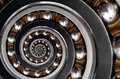 Funny incredible unrealistic industrial Ball Bearing spiral abstract pattern background. Spiral machinery abstract fractal pattern Royalty Free Stock Photo