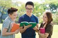 Funny joke image of students reading a in their book Stock Photography