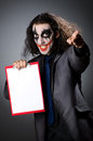 Funny joker with paper binder Stock Photos