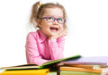 Funny kid girl in glasses reading books Royalty Free Stock Photo