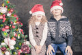 Funny kids at Christmas holiday near decorated christmas tree Royalty Free Stock Photo