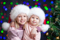 Funny kids in Santa Claus hat on bright background Stock Image