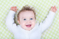 Funny laughing happy baby in green blanket Royalty Free Stock Photo