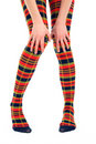 Funny legs in multicolored tights Royalty Free Stock Image