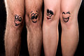 Funny legs showing friendship four Stock Images