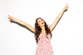 Funny lifestyle portrait of crazy girl, emotional and happy mood, having fun, chic clothes and summer dress. Shows sign Victory. S Royalty Free Stock Photo
