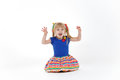 Funny little blond girl with two tails imitating cat Royalty Free Stock Photo