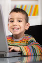 Funny little boy with laptop Royalty Free Stock Photo