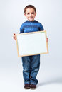 Funny little boy light grey background Stock Photography