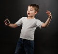 Funny little boy looking at alarm clock Royalty Free Stock Photos