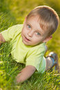 Funny little boy lying on the grass Royalty Free Stock Photo