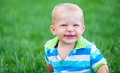 Funny little boy over green grass Royalty Free Stock Image
