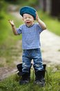 Funny little boy in uniform on grass Royalty Free Stock Images