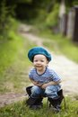 Funny little boy in uniform on grass Royalty Free Stock Image