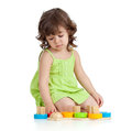 Funny little child playing with colourful toys Stock Photos