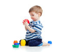 Funny little child playing with cup toys Royalty Free Stock Photography