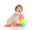 Funny little child playing with cup toys Stock Image