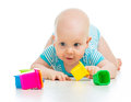 Funny little child is playing with toys over white Royalty Free Stock Image