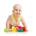 Funny little child playing with toys over white Stock Photography