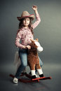 Funny little cowgirl image has attached release Stock Image
