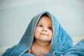 Funny little girl in blue towel Royalty Free Stock Photography