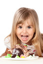 Funny little girl with cake on white Royalty Free Stock Photo