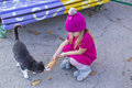 Funny little girl with cat black Stock Photography