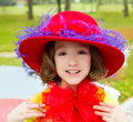 Funny little girl with fashion red hat and tulle bow costume Royalty Free Stock Images