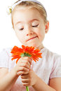 Funny little girl with flower Stock Images