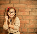 Funny little girl with glasses on brick wall background Royalty Free Stock Image